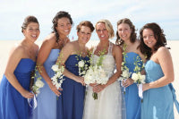 Bridesmaid dresses in different shades of the one color