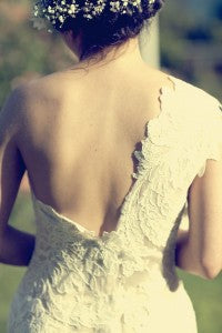 shoulders displayed by one shoulder wedding gowns