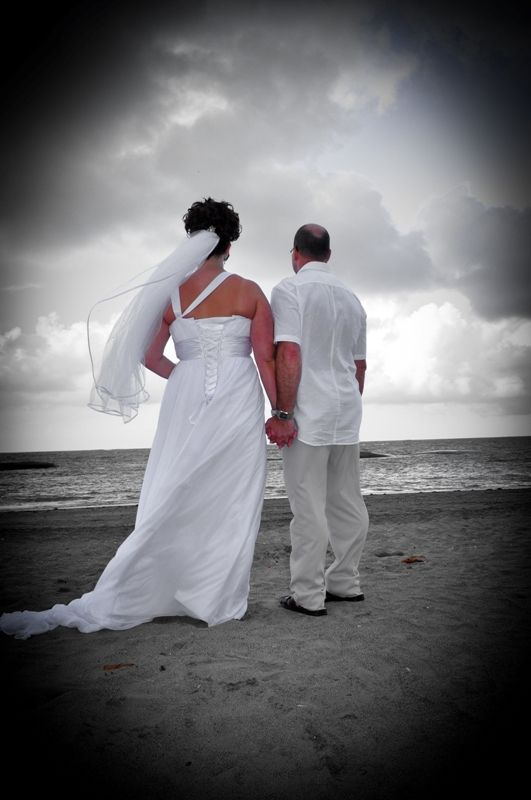 A view of Heidi in her wedding dress on the beach with her husband