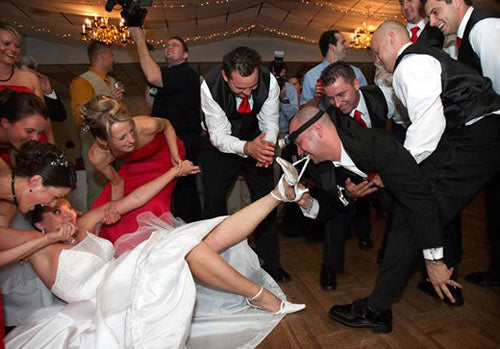 male wedding guests remove bridal garter