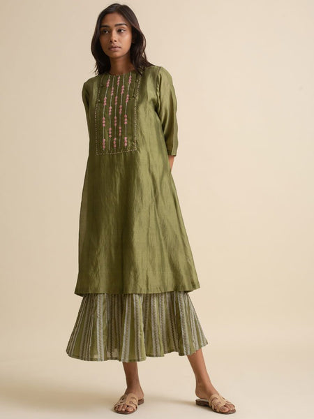Rich olive green color made from Handloom Chanderi with button closure details and a layered inlay