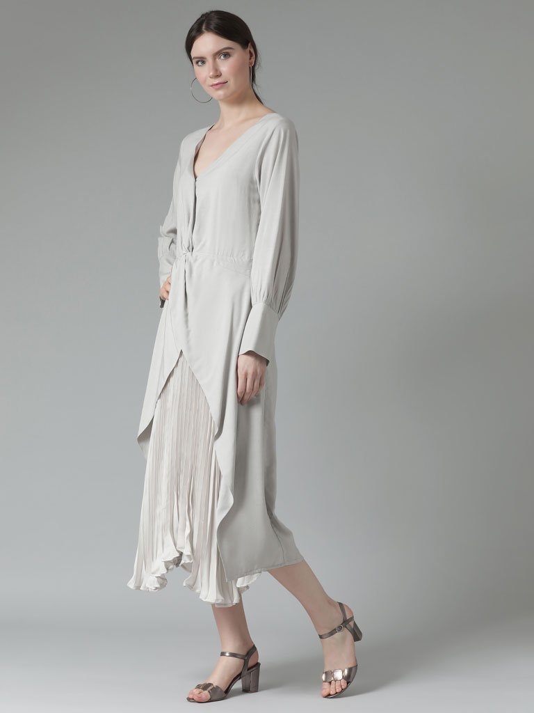 Calf-length dress with accordion pleats in a silky vegan