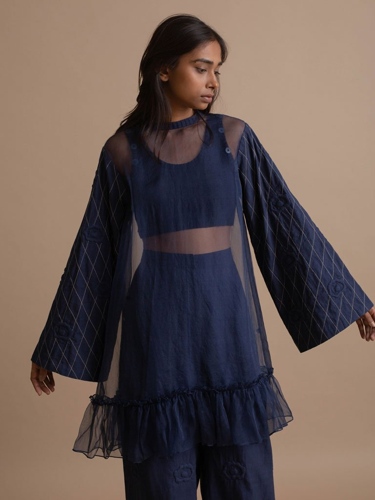 Navy Statement Top with Quilted Sleeve and Ruffle Hemline