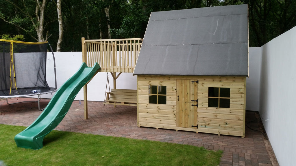 luxury two storey playhouse with swing and slide beyond