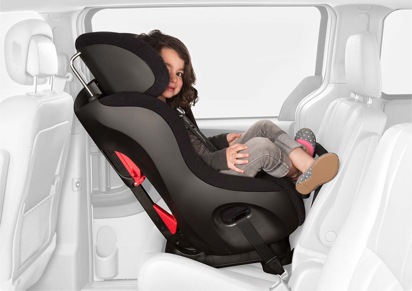 Girl sitting in fllo installed rear-facing.