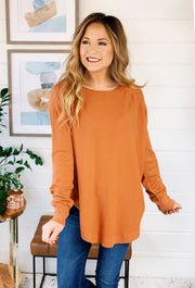 Alena Sweater by Dreamers in Cider, muted orange sweater with round hem and side slit