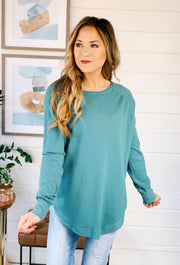 Alena Sweater by Dreamers in Dusty Aqua, teal soft sweater with round hem and side slit