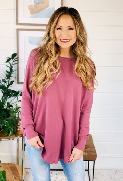 Alena Sweater by Dreamers in Dusty Orchid, dusty purple soft sweater with a round hem and side slit
