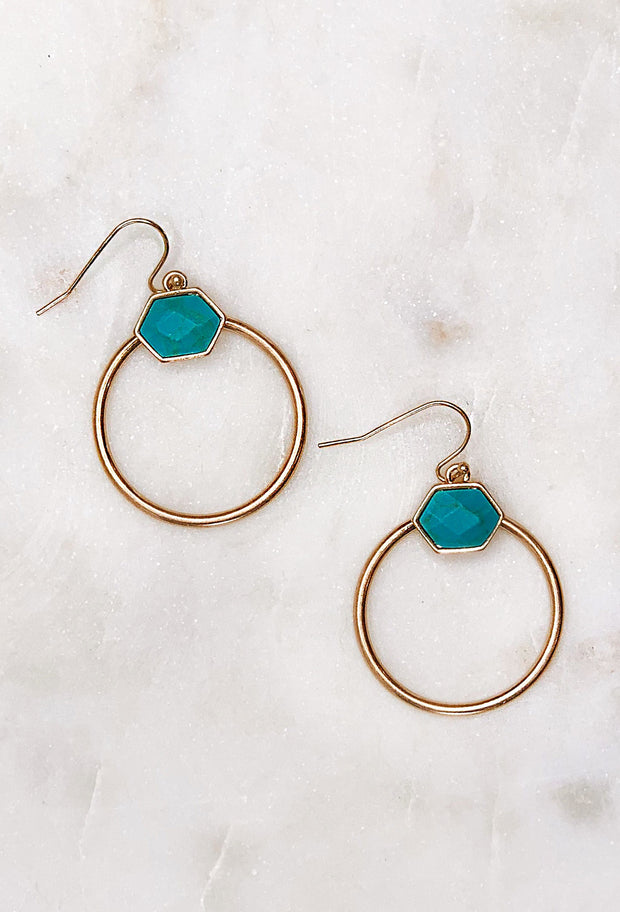 Ava Earrings in Turquoise, gold hoop earrings off hook backing with a turquoise stone