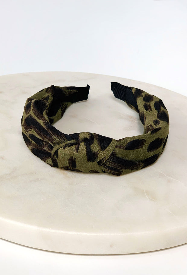 Blake Cheetah Headband in Hunter Green, dark green headband with black cheetah spots and a knot at the top