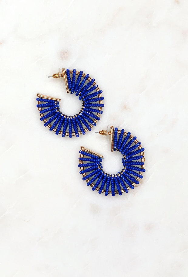 Kasey Cobalt Beaded Earrings, blue tbeaded threads wrapped around a gold hoop on post back