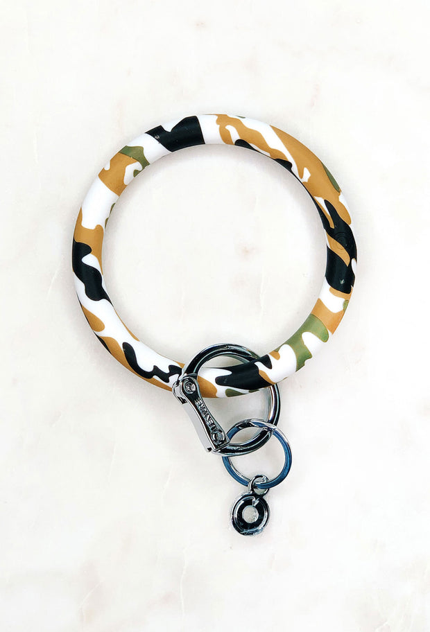 O-Venture Silicone Key Ring in Camo, Camo circle wristlet key ring  Edit alt text