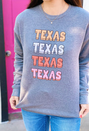 Charlie Southern Bubble State Sweatshirt, gray sweatshirt with Texas written in bubble letters and pink hued colors on the front
