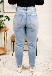 Distressed Mom Jeans by Vervet, light washed mom jeans with a hole in the left knee
