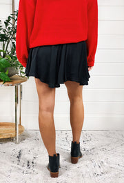 Dulce Skort Skirt in Blackm black satin skirt with shorts underneath and a drawstring waist