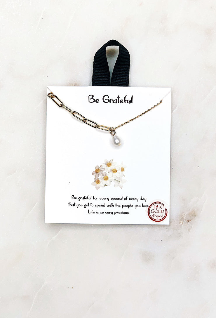 Be Grateful Gold Pearl Necklace, a pearl charm on a double chain - one side normal gold chain and the other a thicker link meeting in the middle