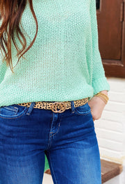 Double Circle Belt in Cheetah, faux calf hair cheetah spotted belt with two intertwining gold circles as the belt buckle