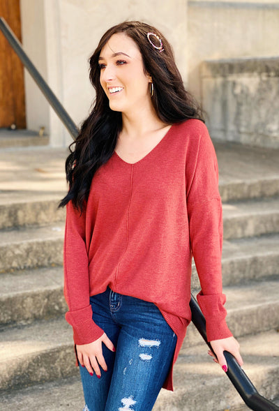 Dreamers Must Have Sweater in Heathered Red Rust, off red soft sweater with seam down the front