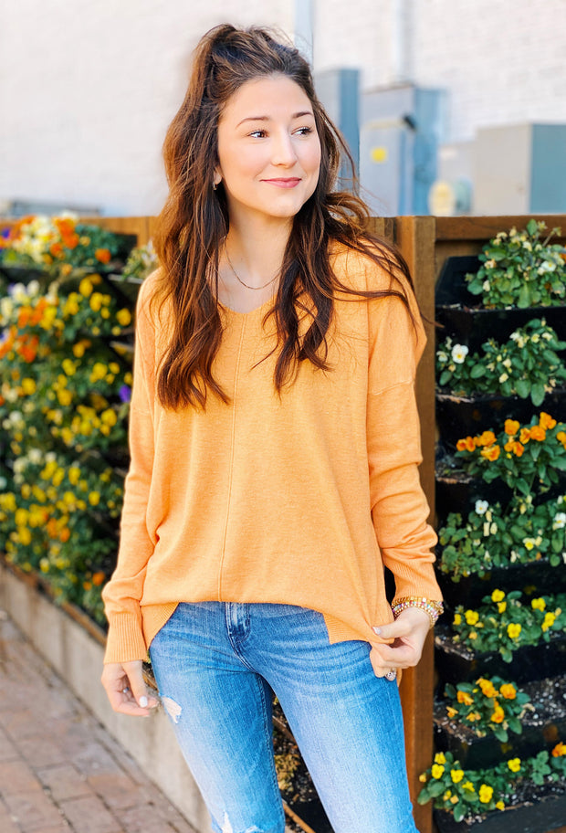 Dreamers Must Have Sweater in Heathered Tangerine, best selling sherbet orange soft sweater with a seam down the front