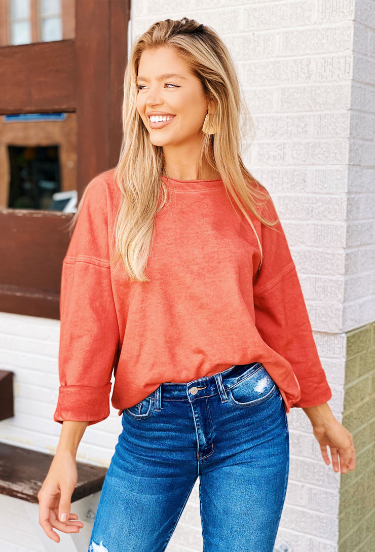 Fern Raw Edge Top in Sunset, bright red/orange  3/4 sweatshirt top with raw edge and cuffed sleeves from urge