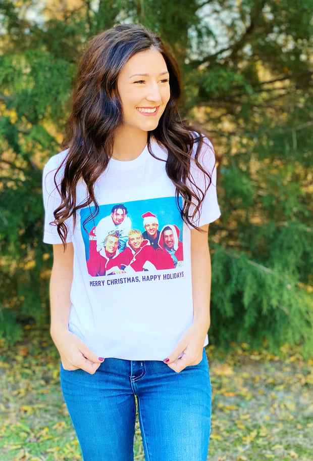 Friday + Saturday: NSYNC Happy Holidays T-Shirt, white graphic tee with the popular 90's boyband NSYNC and the song lyrics 'merry Christmas, happy holidays' underneath