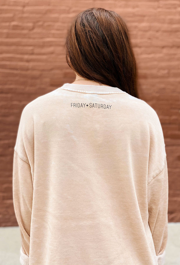 Friday + Saturday: True Crime Campus Crew Sweatshirt, tan soft sweatshirt with black blocked words on the front