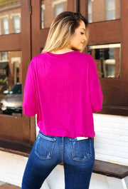 pink top by umgee, top with twist front detail, a bottom band and v-neck, Gabby Gathered Detail Top in Raspberry