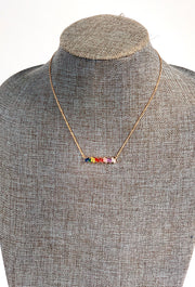 Hazel Rainbow Crystal Bar Necklace, 15 colored rainbow stones alined in a bar necklace on gold chain