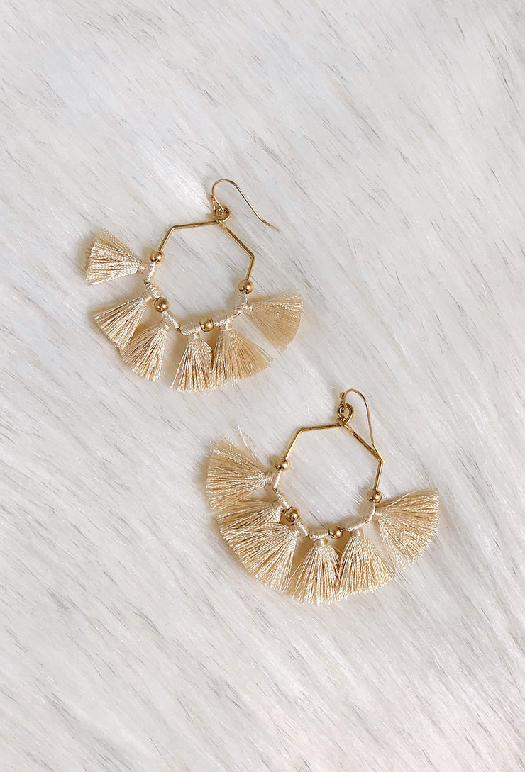Isla Hexagon Tassel Earrings in Ivory, gold hexagon shaped earrings with gold beads and ivory colored tassels hanging off it - on hook backings