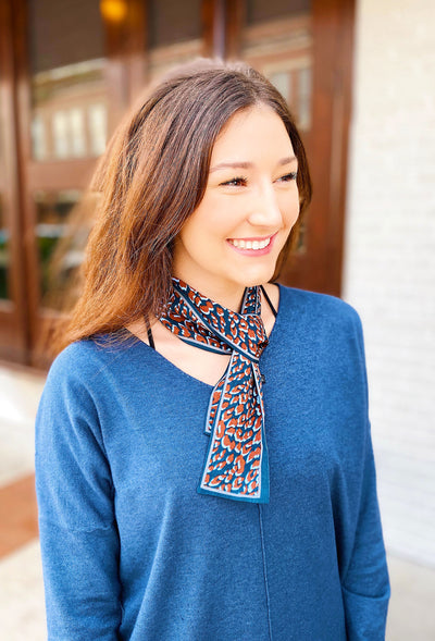 Lena Leopard Scarf Tie in Blue, navy and rust colored cheetah scarf tie