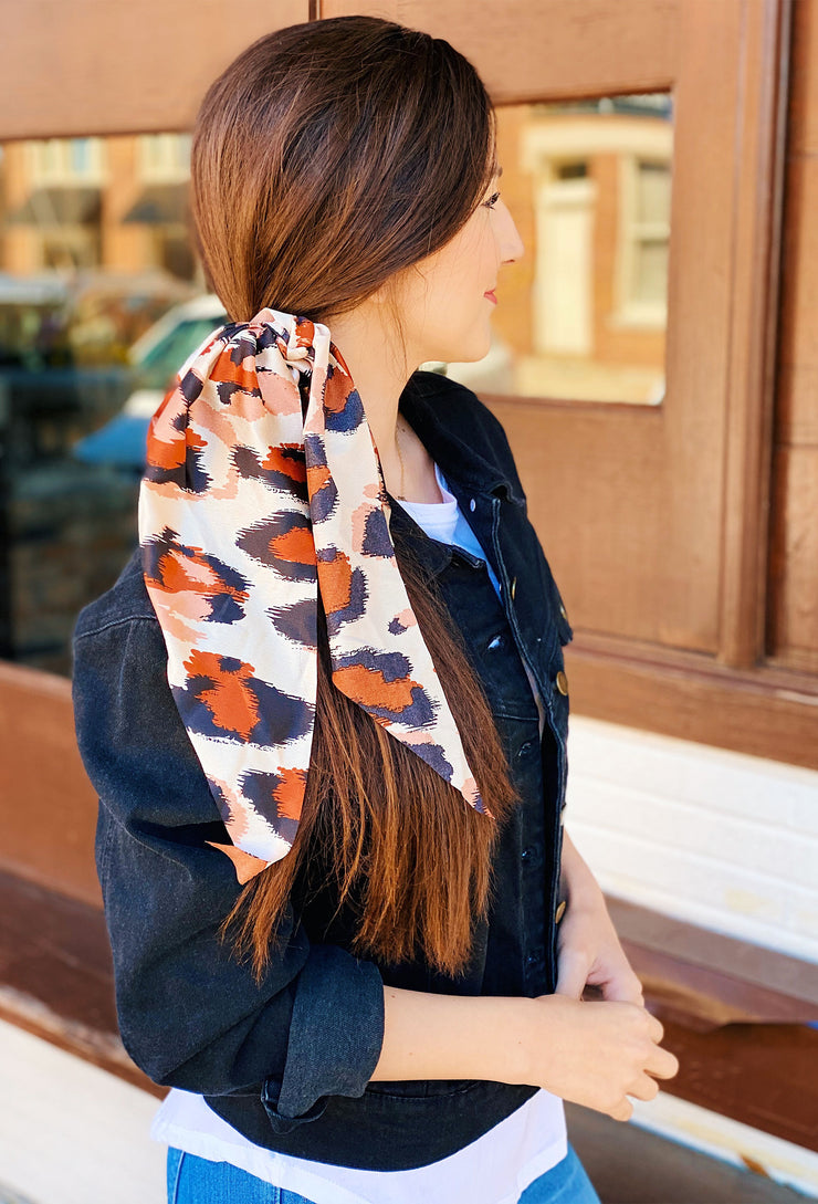 Lynlee Leopard Scrunchie Scarf, champagne silk scrunchies with a pink rust and black leopard printed scarf tied onto it