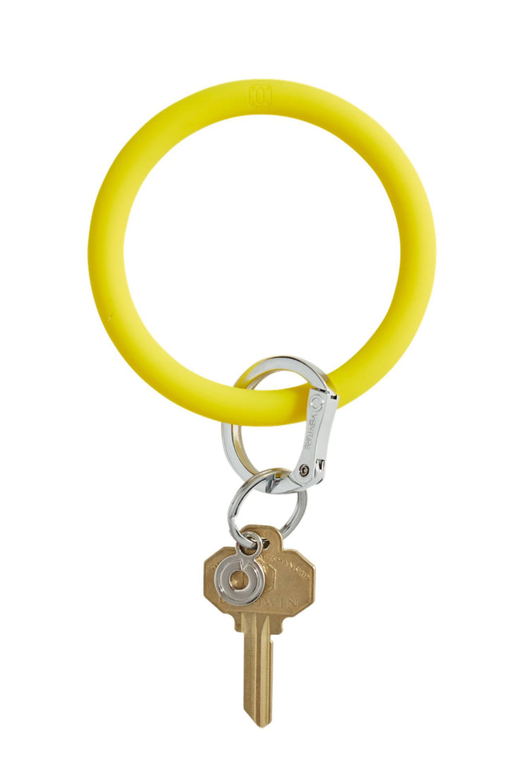 O-Venture Silicone Key Ring in Yes Yellow, yellow circular key ring that can be worn around your wrist