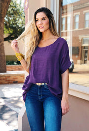 Savannah Dolman Top in Purple, oversized purple top with a sheer overlay and attached tank underneath, features a short dolman sleeve and a longer hemline in back