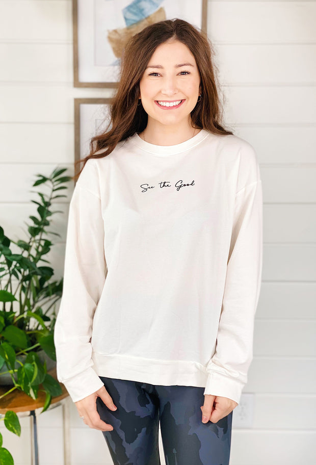 See the Good Sweatshirt Top, white sweatshirt with 'see the good' written in black script