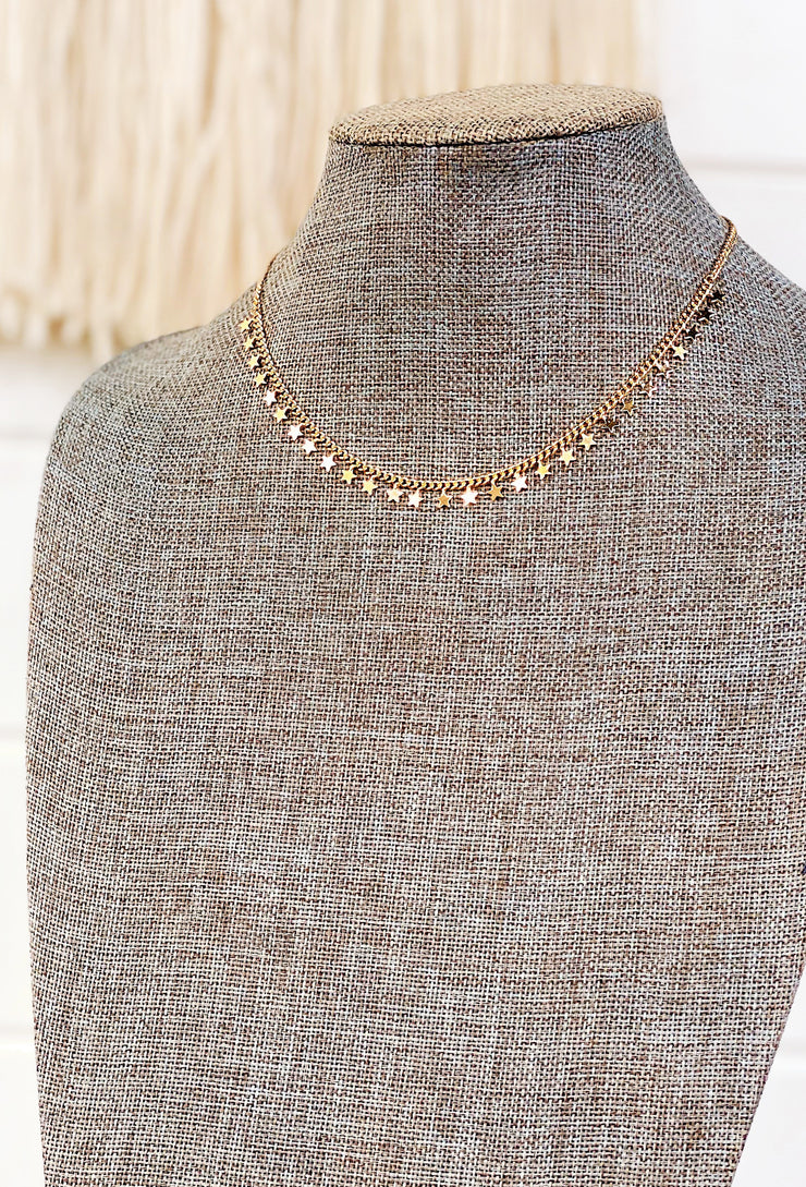 Stars Have Aligned Gold Necklace, gold chain necklace with stars lines up on the bottom half