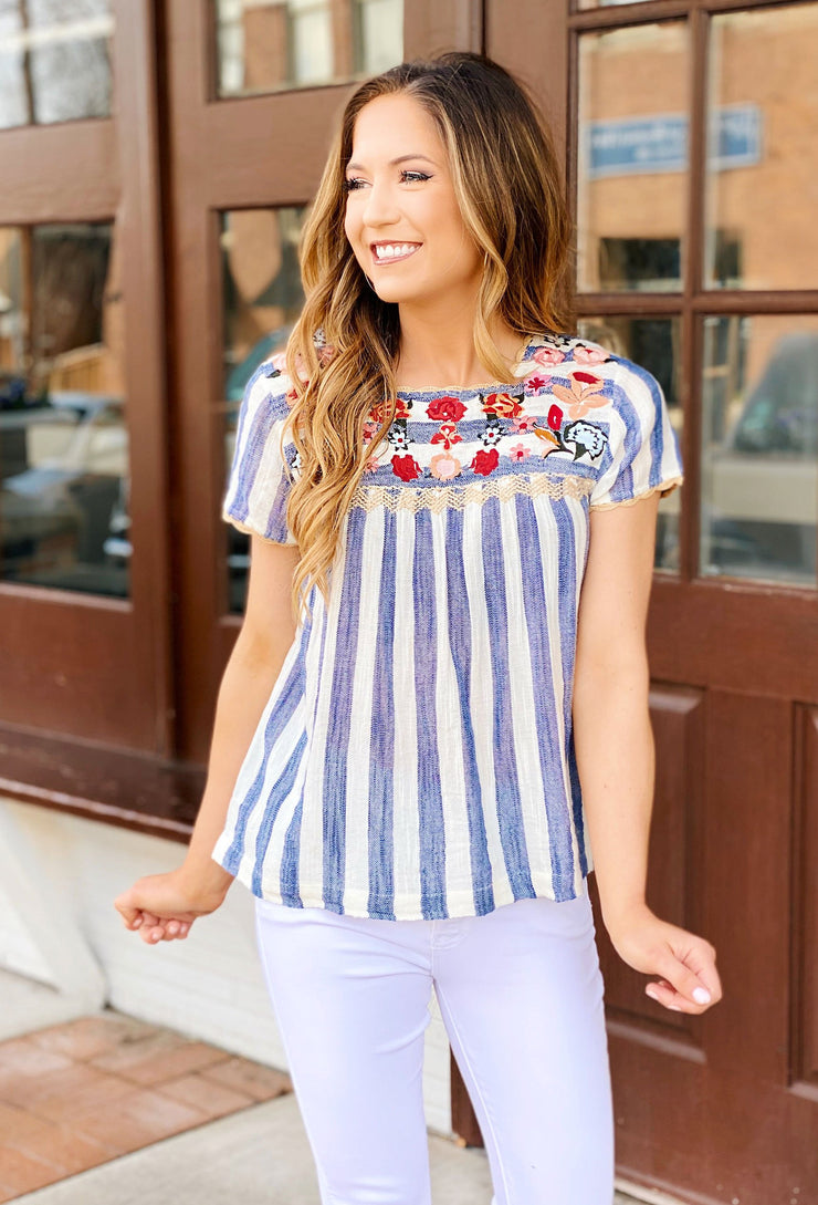 Lottie Floral Embroidered Top, blue and white striped top with floral embroidery around the neckline