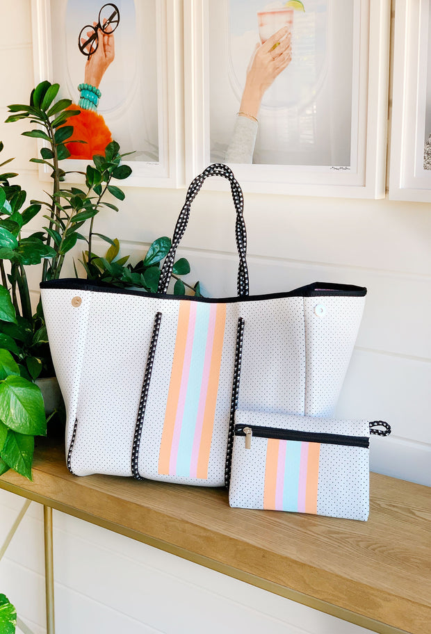 The Jeanne Neoprene Tote, soft antelope print tote with cream and white detailing , cobalt blue neoprene tote with green and white stripe detailing , white neoprene tote bag with pastel stripes down the front and pastel tie dye lining