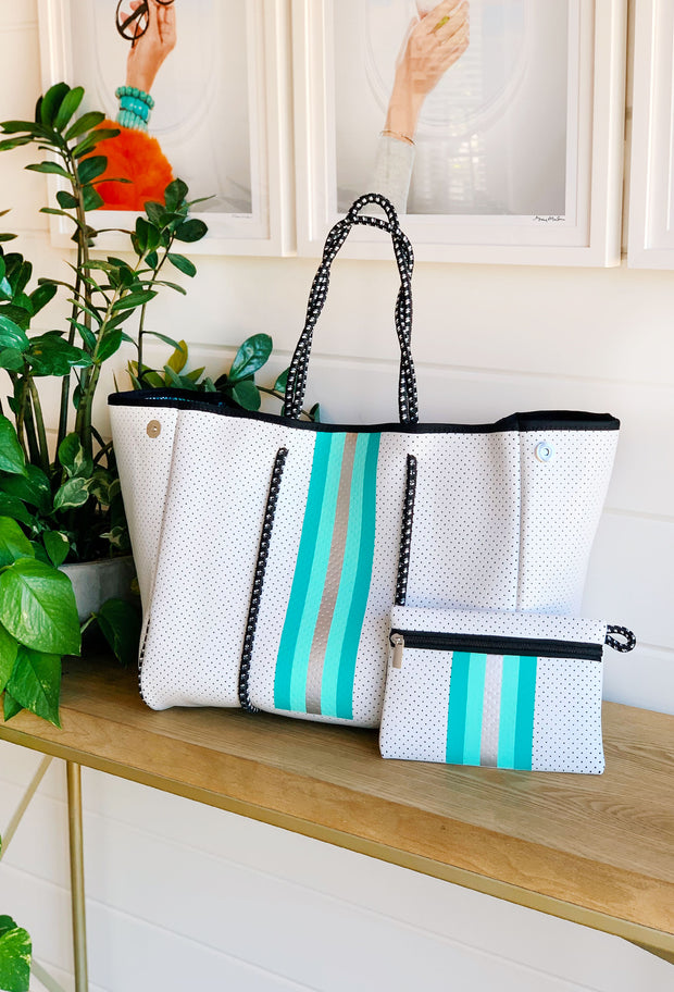 The Shannon Neoprene Tote, white neoprene tote with turquoise and silver stripe down the front and turquoise snake print lining