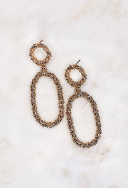 Stardust Gold Statement Earring, gold dangle earrings with stars stacked up for a geometric and rough texture