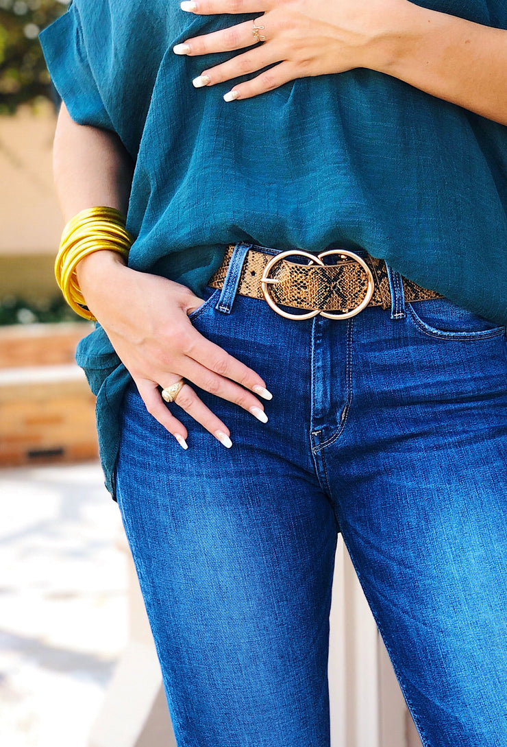 Josephine Belt in Brown Snakeskin, brown snakeskin belt with two intertwining gold circles as the belt buckle