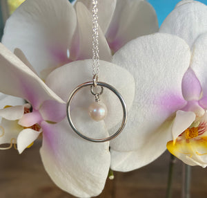 Freshwater pearl and circle of life pendant