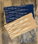 Load image into Gallery viewer, Lilly Cotton Ikat Clutch in Indigo Blue