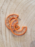 Load image into Gallery viewer, Clear Half Hoops with Gold Flakes in Orange
