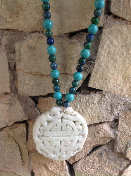 Hand-Carved Melon Green Pendant in Beaded Necklace