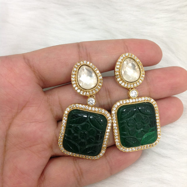 Divinely Carved Green Kundan Earrings