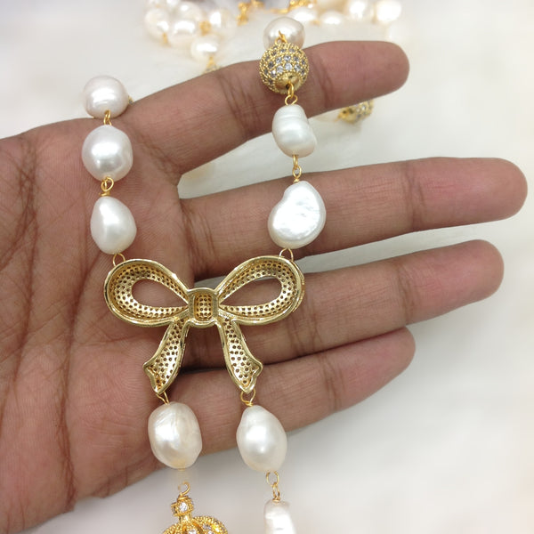 Bow Pendant with Baroque Pearl Necklace