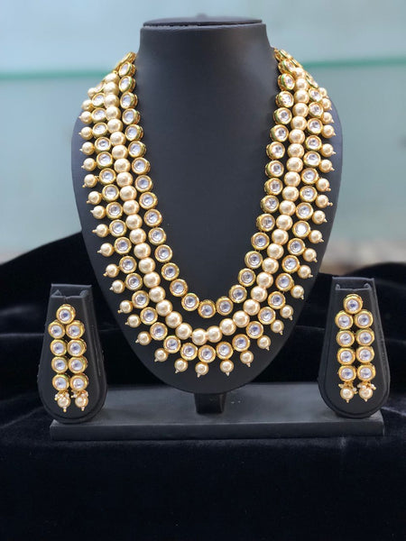 Multi Layered Flaxen Regal Kundan and Pearl Drop Necklace Set