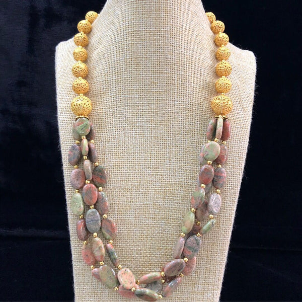 Multicolor Shaded Tumbles wearing Golden Spherules Canopy Necklace