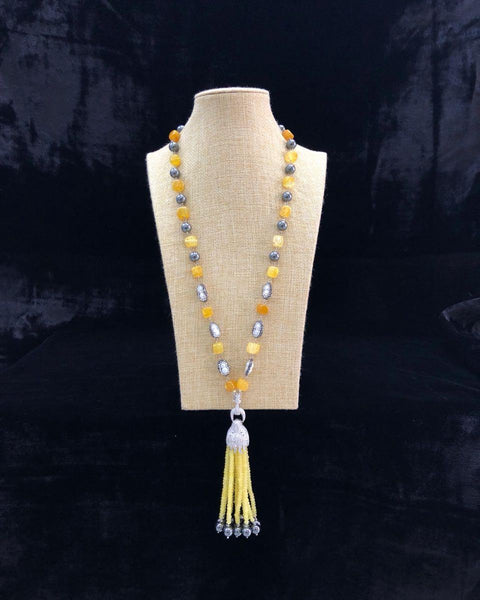 Yellow and White Necklace With Tassel