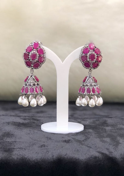 Cubic Zircon and Pearls Pink Jhumka Earrings